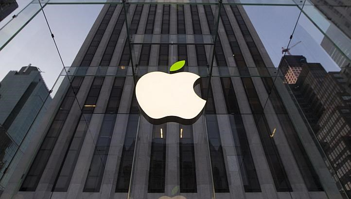 The leaf on the Apple symbol is tinted green at the Apple flagship store on 5th Ave in New York April 22, 2014.