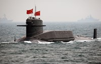 A Chinese Navy submarine attends an international fleet review to celebrate the 60th anniversary of the founding of the People's Liberation Army Navy on April 23, 2009 off Qingdao in Shandong, China.