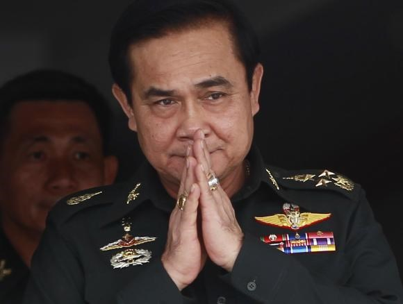 Thailand's newly appointed Prime Minister Prayuth Chan-ocha gestures in a traditional greeting during his visit to the 2nd Infantry Battalion, 21st Infantry Regiment, Queen's Guard in Chonburi province, on the outskirts of Bangkok August 21, 2014.