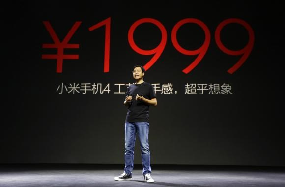 Lei Jun, founder and chief executive officer of China's mobile company Xiaomi, announces the price of the new Xiaomi Phone 4 at its launching ceremony, in Beijing July 22, 2014.