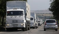 Trucks of a Russian convoy carrying humanitarian aid for Ukraine, drive in the direction of the Ukrainian border near the town of Donetsk, in Russia's Rostov Region, August 22, 2014.