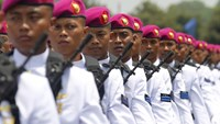 Indonesia's navy soldiers march during a ceremony to mark the 66th anniversary of the Indonesia National Military at the Cilangkap military headquarters in Jakarta.