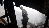 A Ukrainian inside the Youth Culture Center building that was hit by pro-Russian separatists in Donetsk, Ukraine, on Aug. 28, 2014.