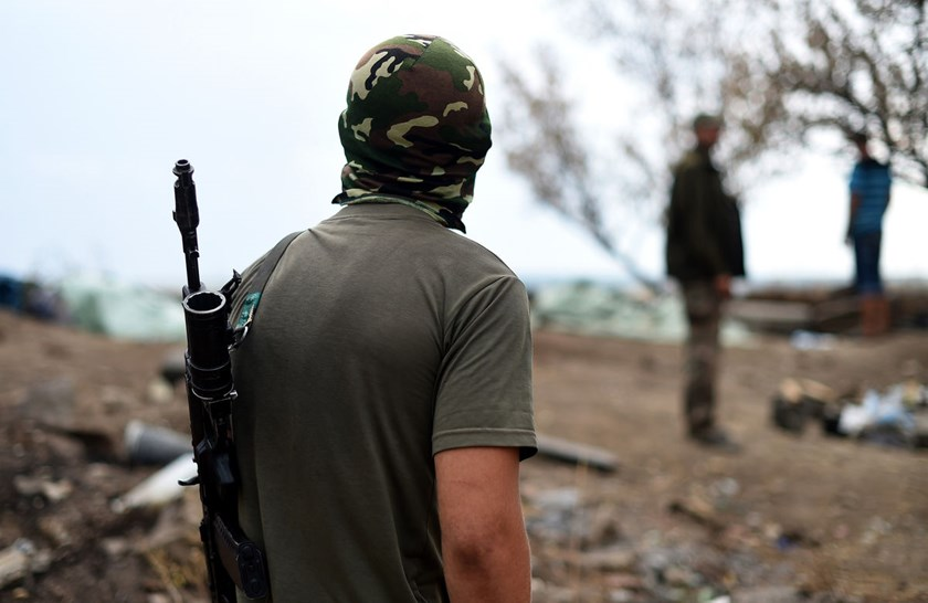 Anti-government fighters stand in Troitsko-Khartsyzk, 30 Km east of Donetsk, on August 28, 2014. The conflict has widened to previously peaceful parts of Ukraine's southeastern regions.
