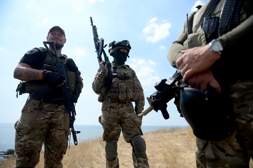 Ukrainian loyalist fighters from the Azov Battalion stand guard on a hill on the outskirts of Mariupol on Aug. 30, 2014.