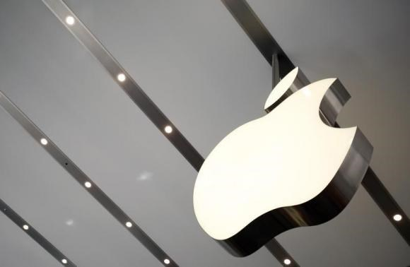 The Apple logo is pictured inside the newly opened Omotesando Apple store at a shopping district in Tokyo June 26, 2014.