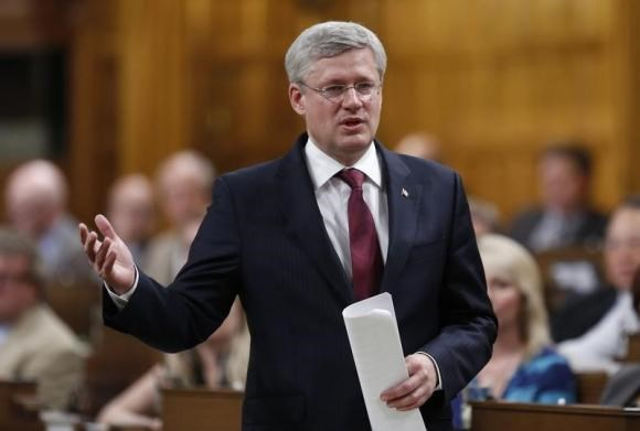 Canada's Prime Minister Stephen Harper speaks during Question Period in the House of Commons on Parliament Hill in Ottawa June 18, 2014.