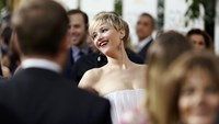Actress Jennifer Lawrence smiles on the red carpet at the 71st annual Golden Globe Awards in Beverly Hills, California January 12, 2014.