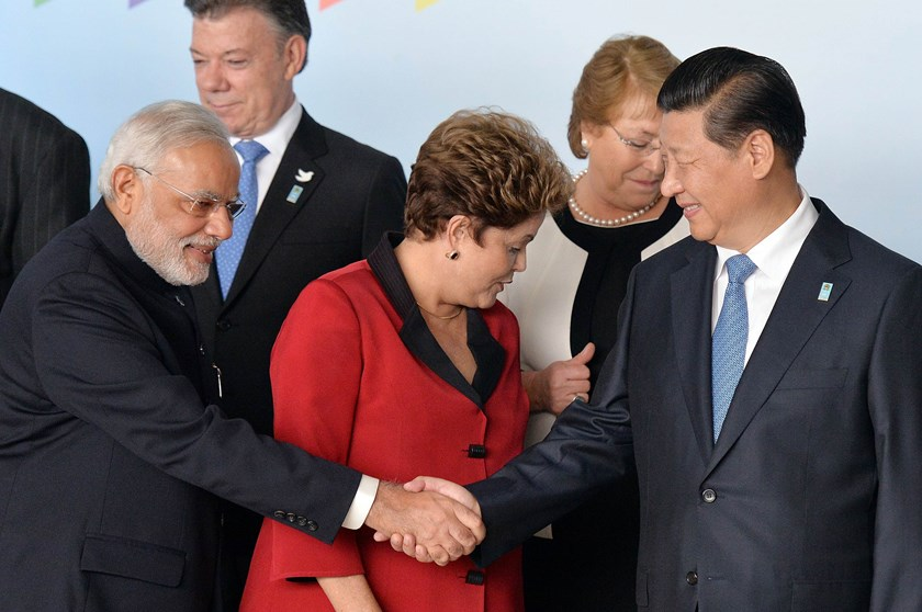India's Prime Minister Narendra Modi (L) and China's President Xi Jinping shake hands before the family photo of the BRICS-UNASUR Summit in Brasilia, Brasil on July 16, 2014.