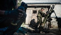 Pro-Russian rebels lead suppressive fire at the positions of Ukrainian army, during shelling in Donetsk, eastern Ukraine, on Sept. 3, 2014.