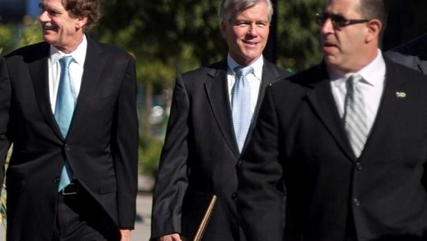 Former Virginia Governor Robert McDonnell arrives with his legal team for his trial in Richmond, Virginia, July 28, 2014.