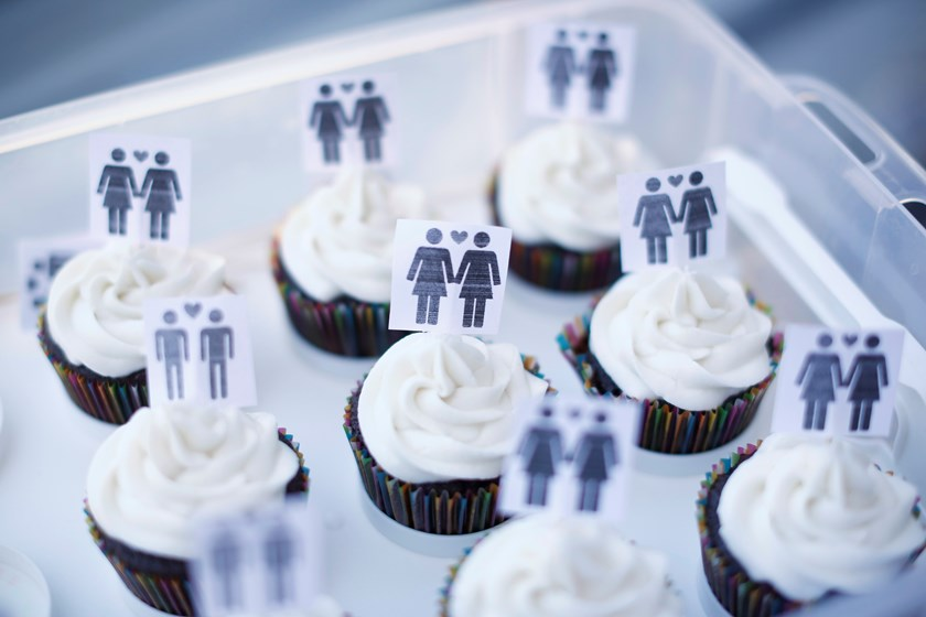 A box of cupcakes are seen topped with icons of same-sex couples at City Hall in San Francisco, June 29, 2013.