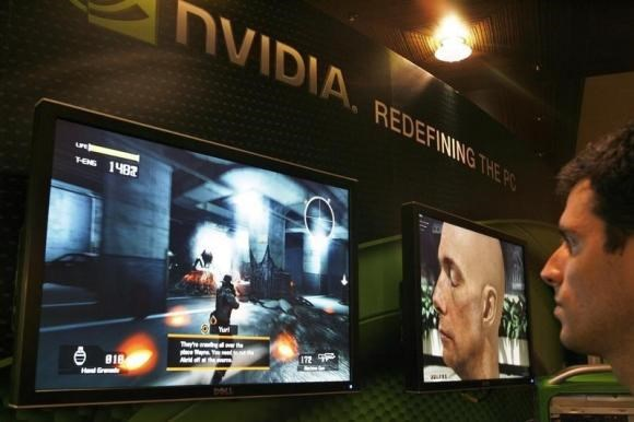 A sales man demonstrates a computer game in a display area of Nvidia Corp. during the second day of the annual 2007 Computex Taipei June 6, 2007.