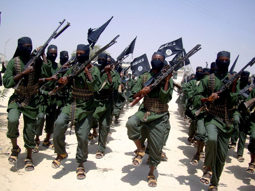 Al-Shabaab fighters march with their weapons during military exercises on the outskirts of Mogadishu, Somalia in 2011.