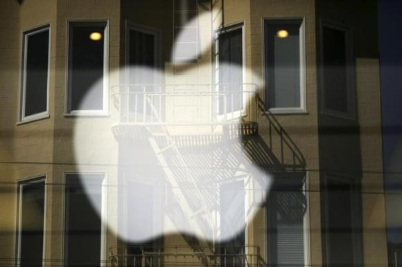 The Apple logo is pictured at a retail store in the Marina neighborhood in San Francisco, California April 23, 2014.