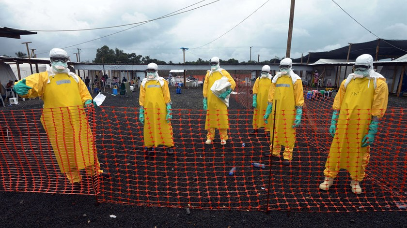 Workers wearing Personal Protective Equipment stand at Elwa hospital, run by Medecins Sans Frontieres, on September 7, 2014 in Monrovia.