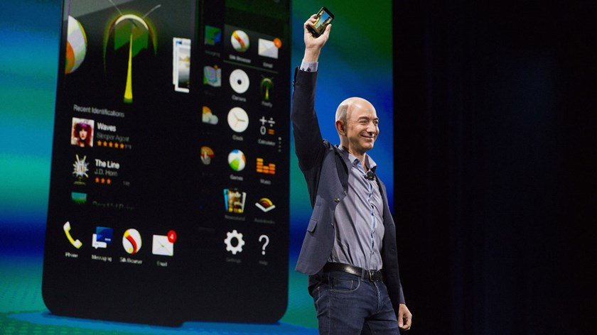 Jeff Bezos, chief executive officer of Amazon.com Inc., unveils the Fire Phone during an event at Fremont Studios in Seattle, Washington, on June 18, 2018.