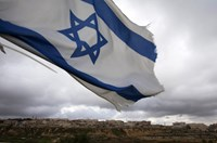 An Israeli flag flies on a hill near the West Bank Jewish settlement of Elazar, near Bethlehem March 17, 2013.