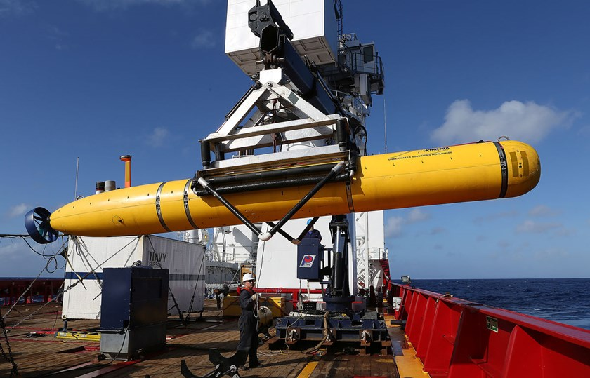In this handout image provided by Commonwealth of Australia, Department of Defence, The Phoenix International Autonomous Underwater Vehicle Artemis is craned over the side of Australian Defence Vessel Ocean Shield in the search for missing Malaysia Airlin