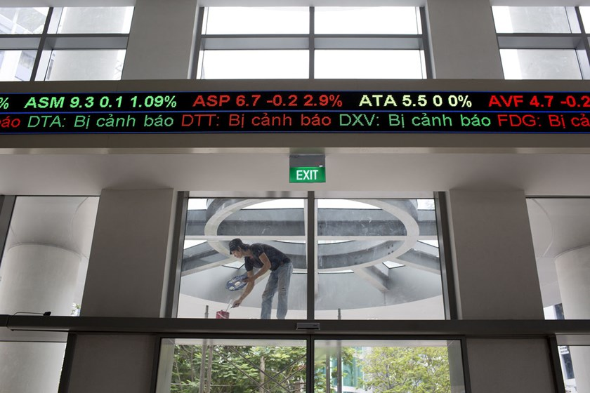 An electronic stock ticker displays share prices in the Ho Chi Minh Stock Exchange in Ho Chi Minh City, Vietnam.