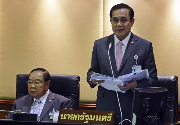 Thailand's Prime Minister Prayuth Chan-ocha (R) reads out his government's policy, as Deputy Prime Minister and Defence Minister Prawit Wongsuwan listens, at the Parliament in Bangkok September 12, 2014.