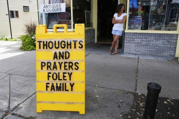 A sign outside a shop remembers James Foley in his hometown of Rochester, New Hampshire August 20, 2014.
