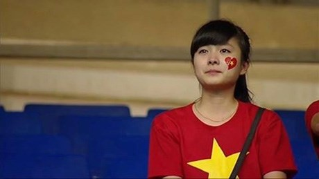 Vietnamese football fan cries after home team loss to Japan