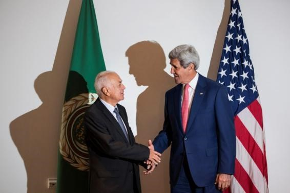 Arab League Secretary-General Nabil al-Araby (L) and U.S. Secretary of State John Kerry shake hands before a meeting in Cairo September 13, 2014.