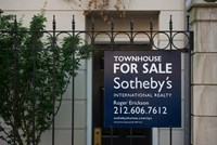 "A Sotheby's ""For Sale"" sign is displayed outside of a townhouse in New York, U.S."
