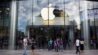 Customers exit an Apple Inc. store in the Wangfujing area of Beijing, China.