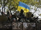 Ukrainian servicemen ride on an armored vehicle near Kramatorsk September 15, 2014.