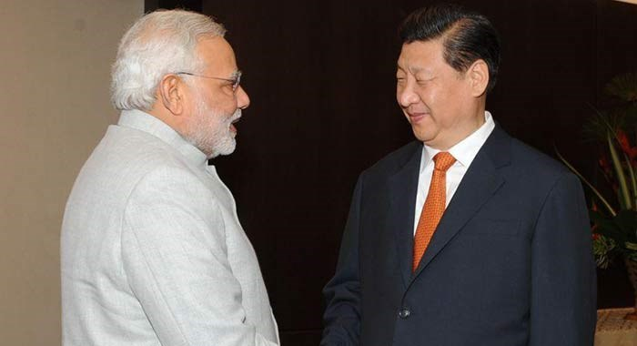 Xi sees factory China and back office India as global engine