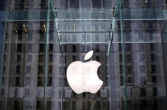 The Apple logo hangs inside the glass entrance to the Apple Store on 5th Avenue in New York City, April 4, 2013.