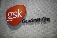 The logo of GlaxoSmithKline (GSK) is seen on its office building in Shanghai July 12, 2013.