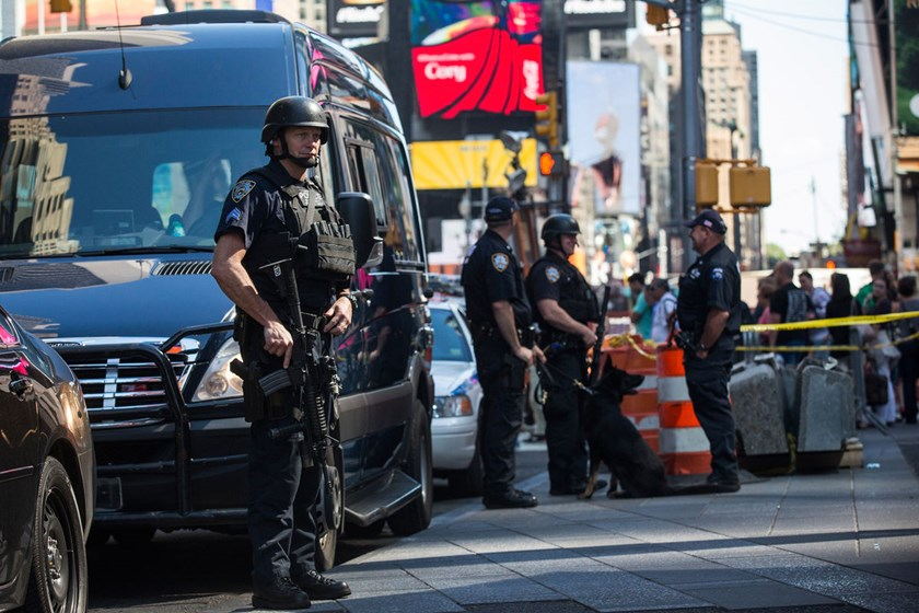 New York City police officers stand guard in Times Square in New York City, on Sept. 17, 2014. A blog affiliated with the Islamic State in Iraq and Syria mentioned Times Square as a target for bombing.