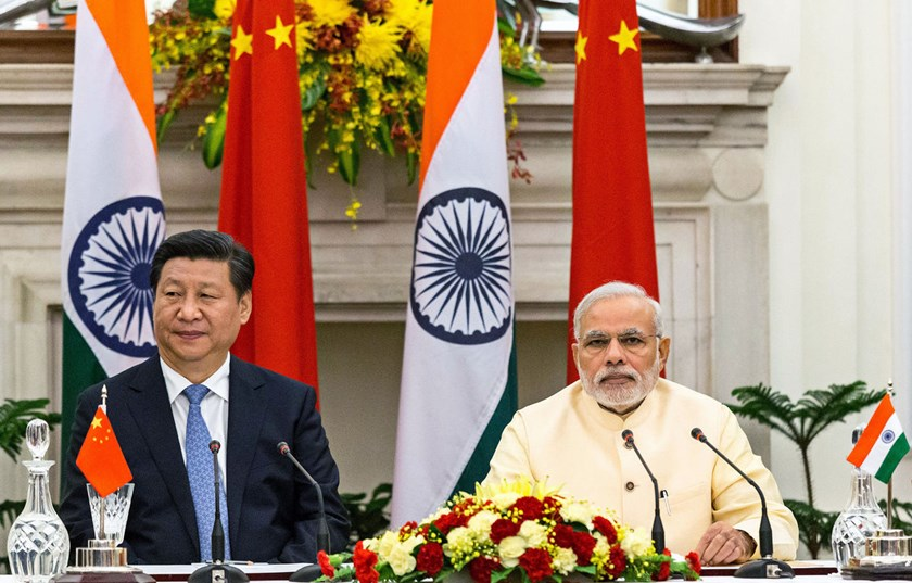Narendra Modi, India's prime minister, right, and Xi Jinping, China's president, attend a meeting to sign a series of agreements between the two nations at Hyderabad House in New Delhi, India, on Sept. 18, 2014.