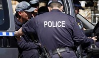 Police stand outside a house that was involved in pre-dawn raids in the western Sydney suburb of Guilford September 18, 2014.