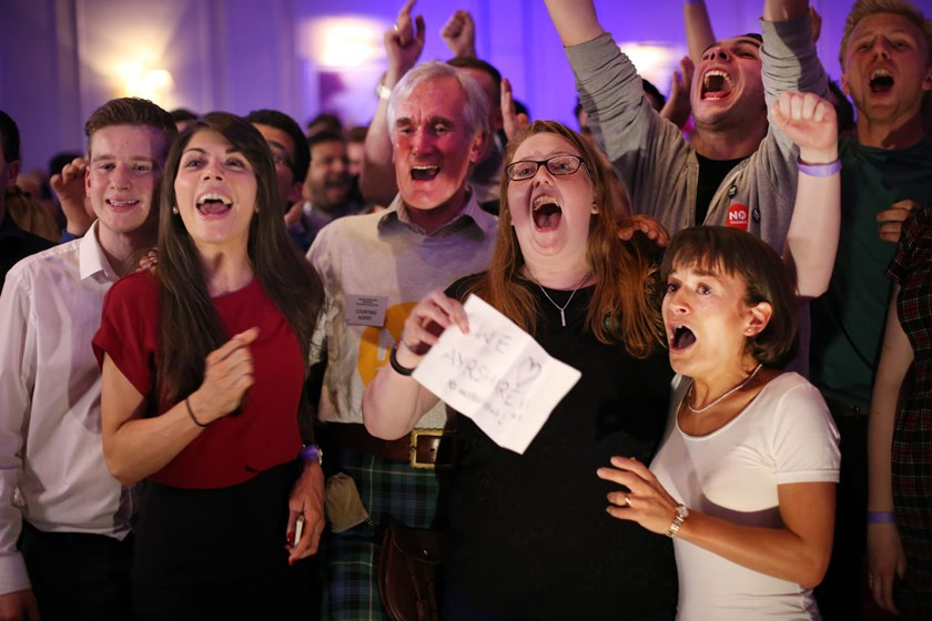 Better Together campaigners celebrate poll results at a party in Glasgow, Scotland, on Sept. 19, 2014.