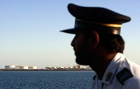 A security personnel looks on at oil docks at the port of Kalantari in the city of Chabahar, 300km (186 miles) east of the Strait of Hormuz January 17, 2012.
