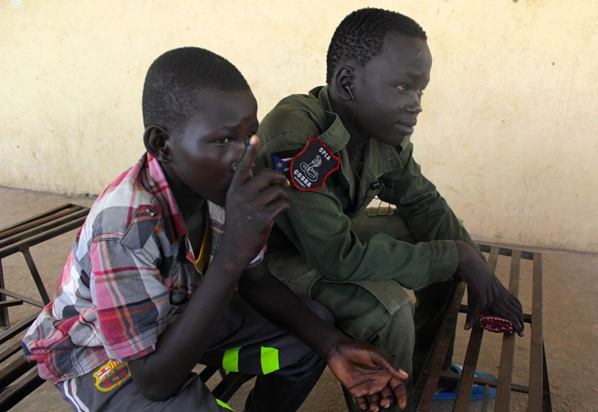 Bol Olor Ding, 14, left, and Kamis Ngor Ajack, 15, joined South Sudan's army as fighting raged in their Upper Nile state for the past nine months.