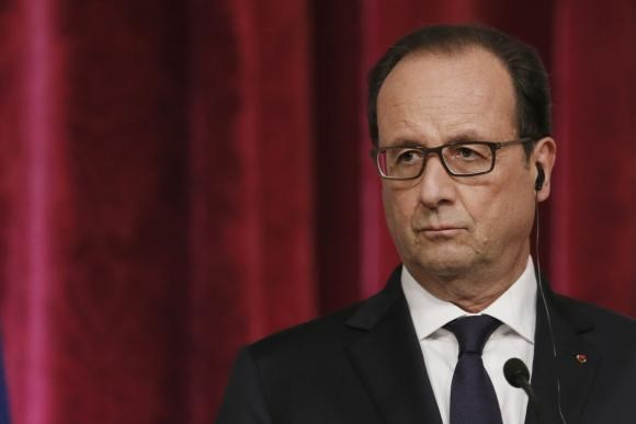 France's President Francois Hollande attends a joint news conference with Palestinian President Mahmoud Abbas (not pictured) at the Elysee Palace in Paris September 19, 2014.