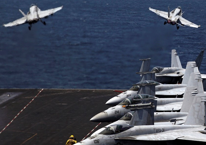 F/A-18 fighter jets take off for mission in Iraq from the flight deck of the U.S. Navy aircraft carrier USS George H.W. Bush.