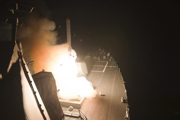A Tomahawk cruise missile is launched against Islamic State targets from the US Navy guided-missile destroyer USS Arleigh Burke, in the Red Sea, September 23, 2014.