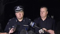 Assistant Commissioner of Victoria Police Luke Cornelius (L) speaks to the media outside the Endeavour Hills Police Station after an altercation in the vicinity, in Melbourne, in this still image taken from video shot on September 24, 2014.