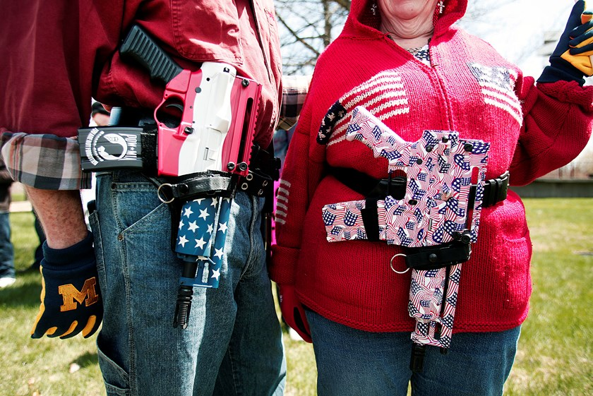 Decorated Olympic Arms .223 pistols at a rally for supporters of Michigan's Open Carry law on April 27, 2014 in Romulus, Michigan.