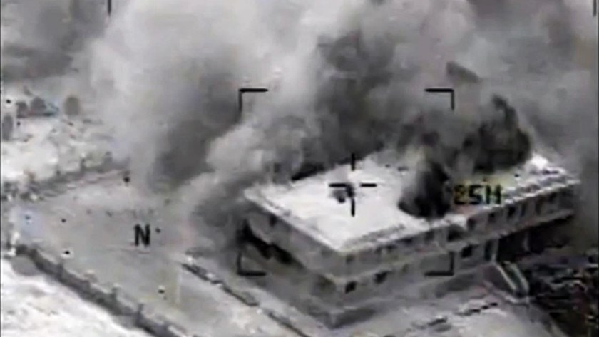 This still image made from video released by the U.S. Central Command on Sept. 23, 2014, shows a structure in Tall Al Qitar, Syria, moments after a U.S. airstrike.