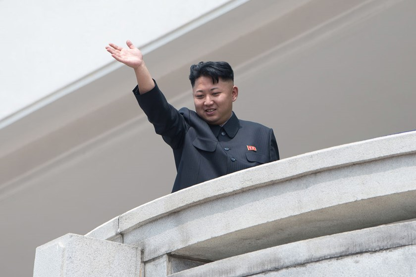 North Korean leader Kim Jong-un waves to the crowd during a military parade at Kim Il-Sung square in Pyongyang, North Korea, on July 27, 2013.