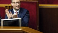 Ukraine's Prime Minister Arseny Yatseniuk reacts during a session of the parliament in Kiev August 14, 2014.