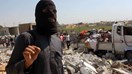 An image grab taken from an AFPTV video on Sept. 16, 2014 shows a jihadist from the Islamic State group standing on the rubble of houses after a Syrian warplane was reportedly shot down by IS militants over the Syrian town of Raqa.