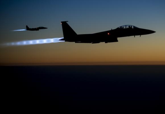 A pair of U.S. Air Force F-15E Strike Eagles fly over northern Iraq after conducting airstrikes in Syria, in this U.S. Air Force handout photo taken early in the morning of September 23, 2014.